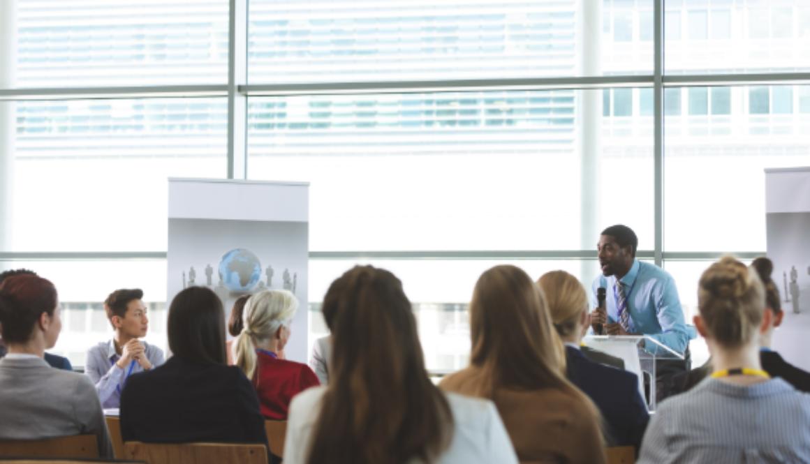 speaking-in-a-business-seminar-in-modern-office-bu-9TFNUP5